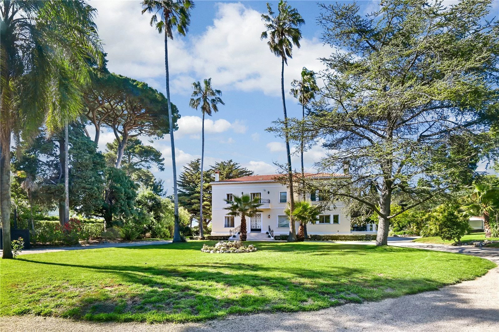 Buying Villa Cap d'Antibes Outstanding waterfront property, set in landscaped grounds with heated pool, pool house, tennis court and garage.