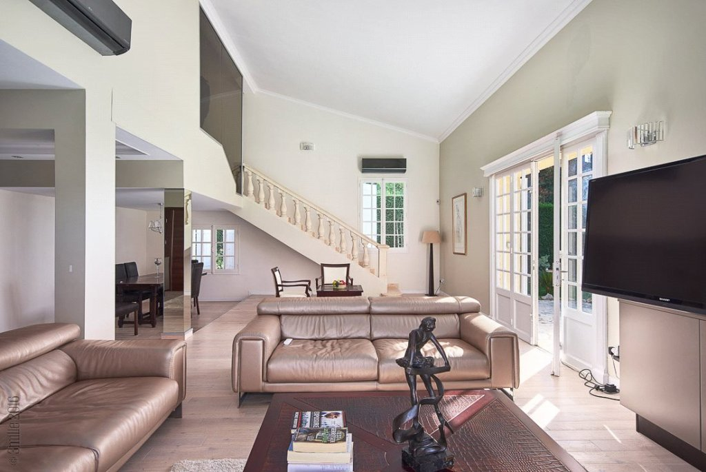 Buying Villa Mougins Situated within a gated estate, this completely refurbished family home of approximately 250 sq m is set in landscaped grounds with heated pool and 2 garages.